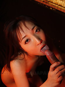 Caged Japanese beauty is ready to suck a huge pecker with pleasure