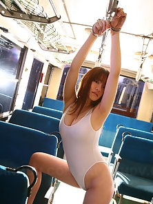 Cute red haired girl Yayoi Yoshino gets handcuffed on a bus and poses