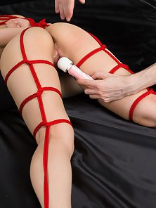 Tied up submissive Asian chick gets her cunt toyed