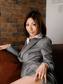 Classy Looking Young Asian Bitch Exposing Her Hot Poses on the Couch