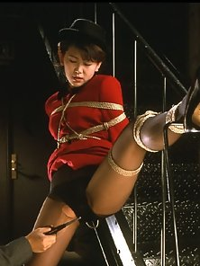 Naughty Japanese Bondage Babe Hammered Hard By a Hunky Guy From Behind
