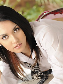 Naughty school girl Maria Ozawa poses on the floor and reveals curves