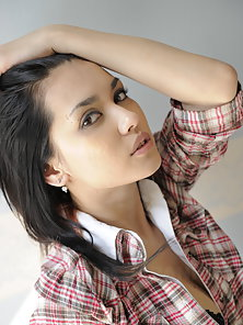 Dark haired hottie Maria Ozawa shows her boobs to the cam on the chair