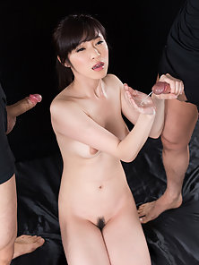Cute Asian brunette works their dicks with hand and mouth