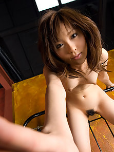 Cutie Asian Babe Rin Sakuragi Strips Her Panty and Displaces Her Hairy Pussy on Couch