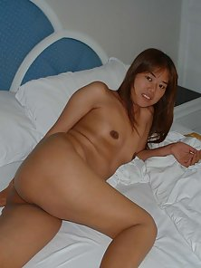 Big Tits Asian Babe Spreds Her Legs and Shows Her Pussy for Pleasure
