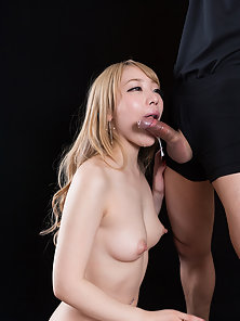 Blonde Asian getting her mouth filled with huge load