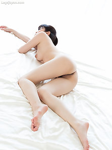 Close up on hot Asian working his dick with feet