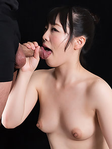 Adorable brunette Asian sucking on a cock