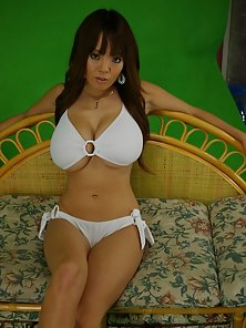 Sensual Brunette Babe Huge Boob in White Bra on Couch