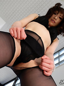 Okita Chikako working her clients cock with her feet