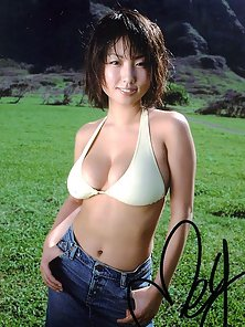 Sweet Busty Chick Megumi Displaying Her Huge Boobs