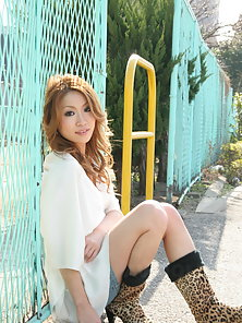 Momomi Sawajiri in boots, blouse and shorts is very playful outdoors.