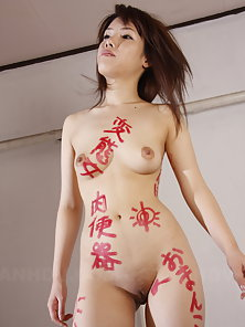 Dark haired Remi Kawamura poses totally naked on the set, showing twat