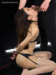 Lovely Asian chick in black bikini gags on a dick