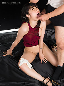 Adorable Asian chick in hot red dress gagging on a dick
