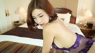 Gorgeous asian beauty posing and stripping in sexy lingeries