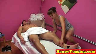 Pretty Masseuse Giving Jerking Pleasure to Client