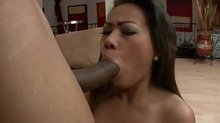 Asian amateur gets big black cock in her mouth