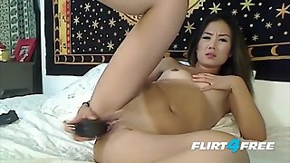 Long dark haired Jade Phee dildoing herself good