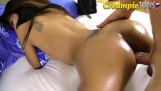Oiled up her perfect Thai booty then fucked her hard