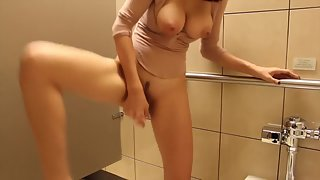 Big titty Asian dildo fucking herself in bathroom