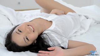 Beautiful Asian is masturbating on white bed